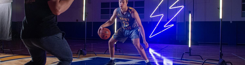 Photographer photographing a basketball player