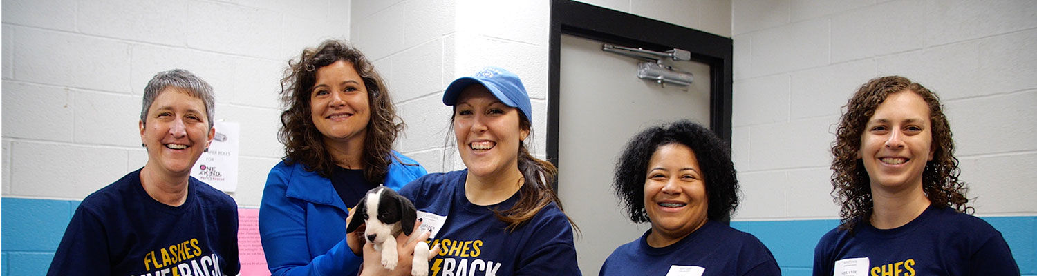 Kent State alumni smiling and posed for the camera during Alumni Day of Service