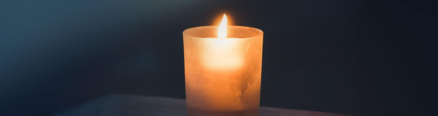 Photo of a lit candle