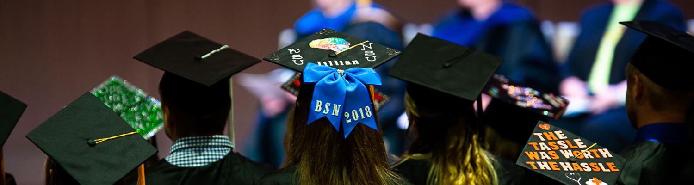 Graduation caps at ceremony