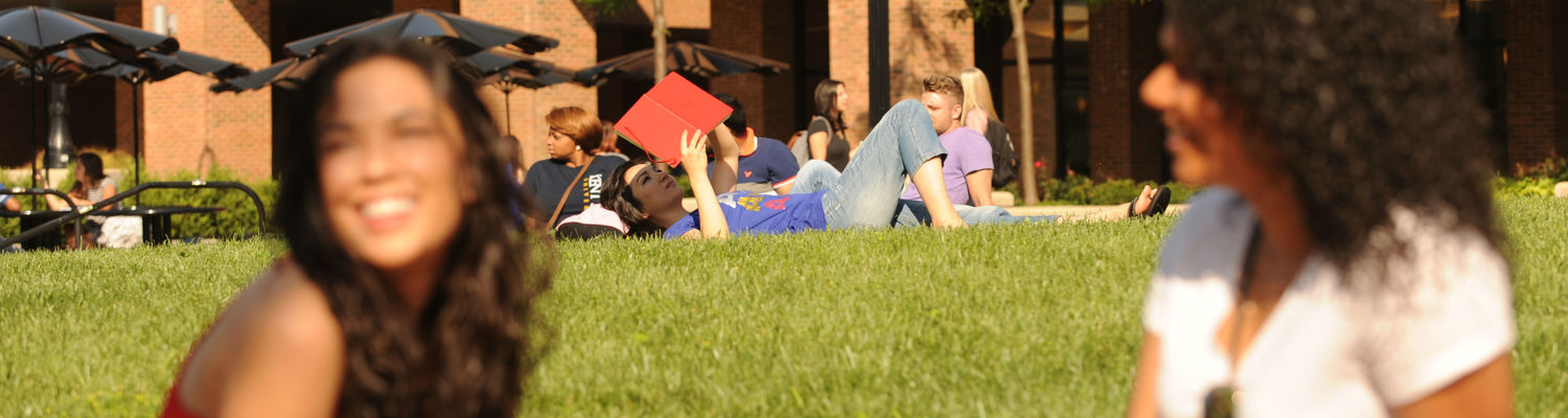 Student on Lawn Reading