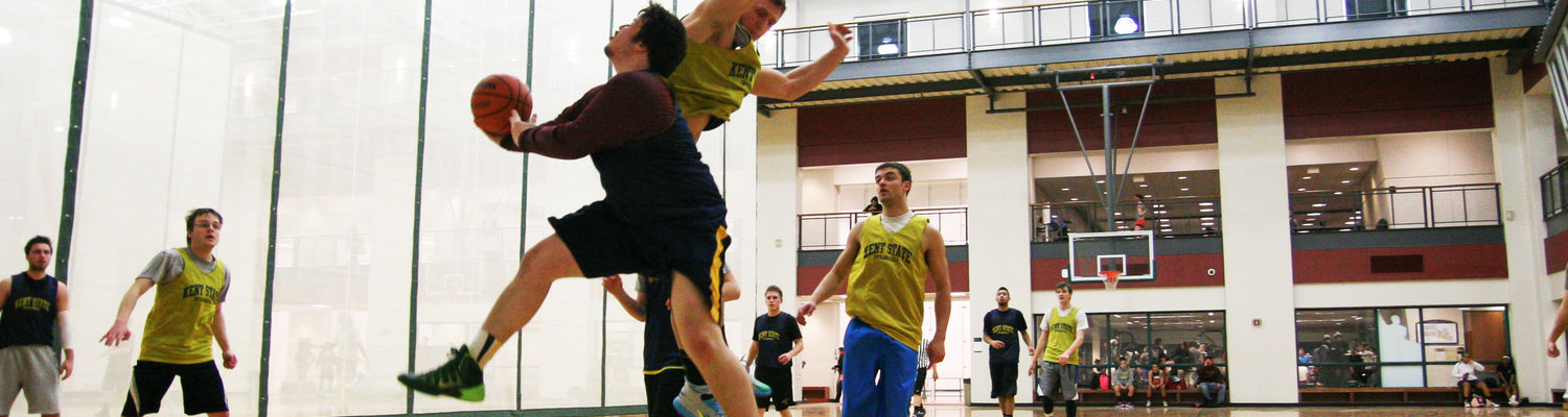 A group of students play a game of basketball at the Kent State Recreation and Wellness Center.