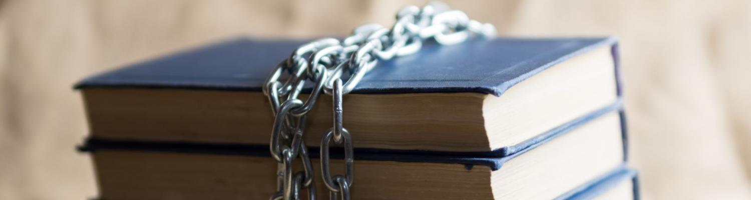 Book with chains to represent banned books