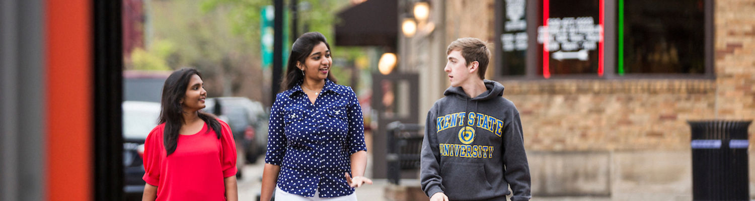 Diverse students in casual conversation on the street