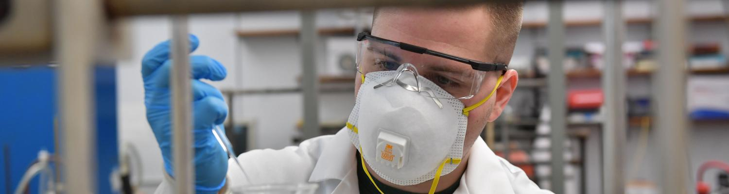 Kent State University graduate student doing research in a chemistry lab