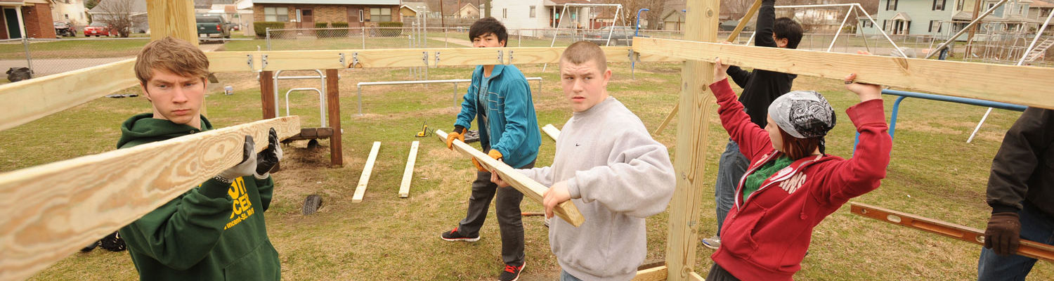 Students from the Kent Campus build a playhouse at a park in East Liverpool as part of an alternative spring break, in which students spend a week performing community service.