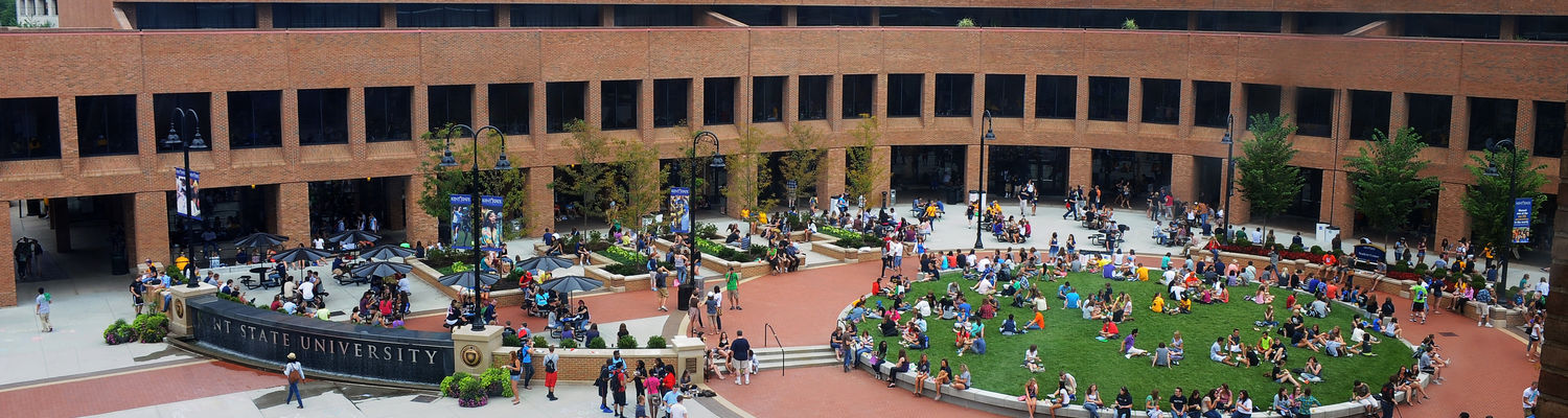 Students take advantage of a warm, sunny day on the newly rebuild Risman Plaza. The plaza is a hub of activity on the Kent State campus.