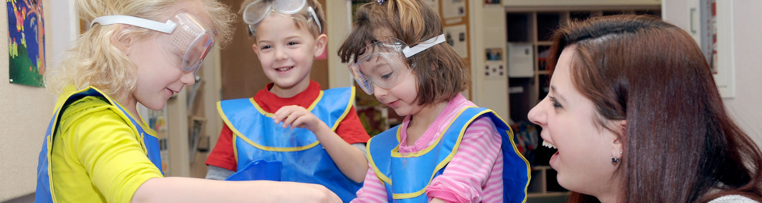 Kids at the Child Development Center play with science during a special event held at the center.