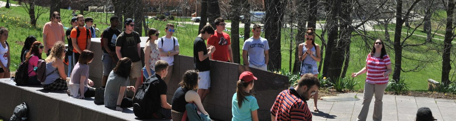Students listening to a lecture about the May 4 Memorial