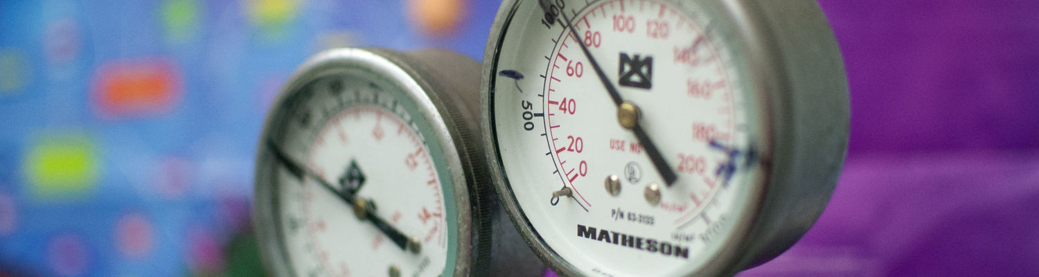 A gauge on a gas cylinder in a research lab.