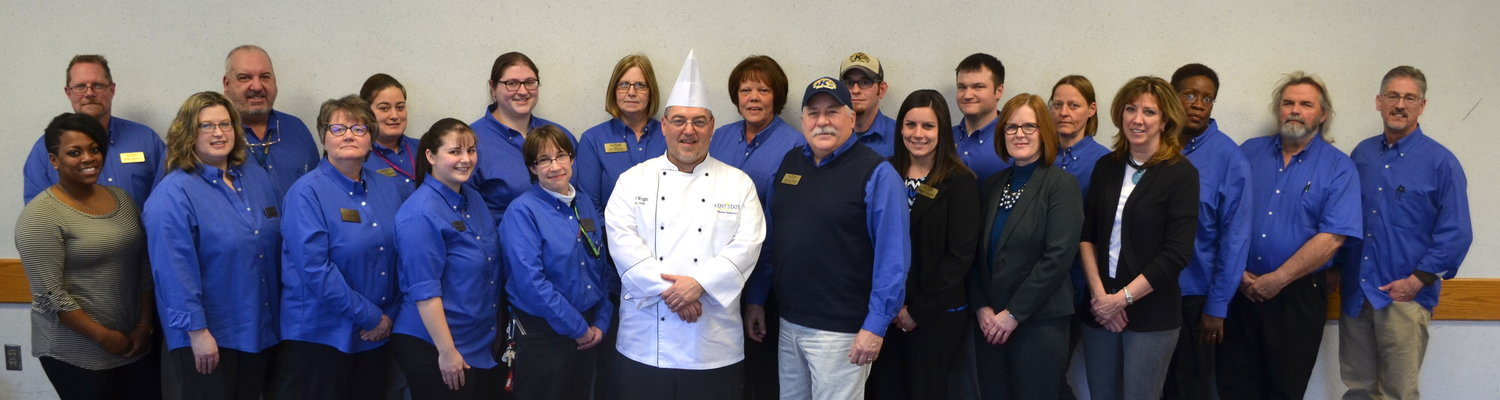 Members of the Dining Services management team stand together for a group photo