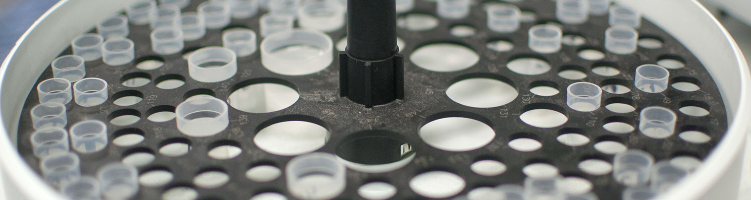 A close-up photo of part of an instrument in an inorganic research lab.