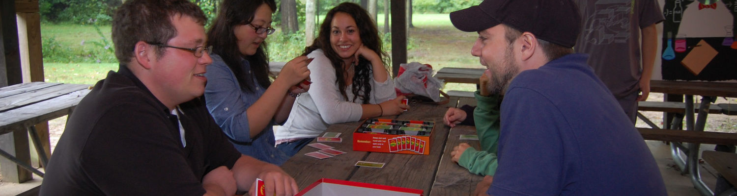 Faculty and students play board games.