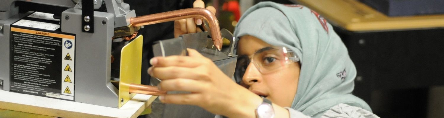 A student working with tools