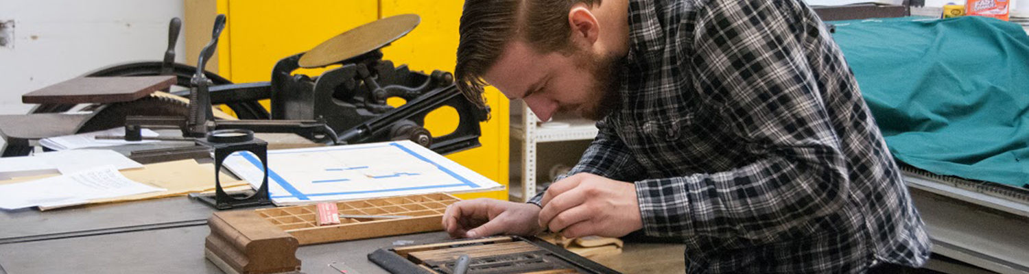 Students in the Type High Press course employ graphic design skills with hand operated printing presses.