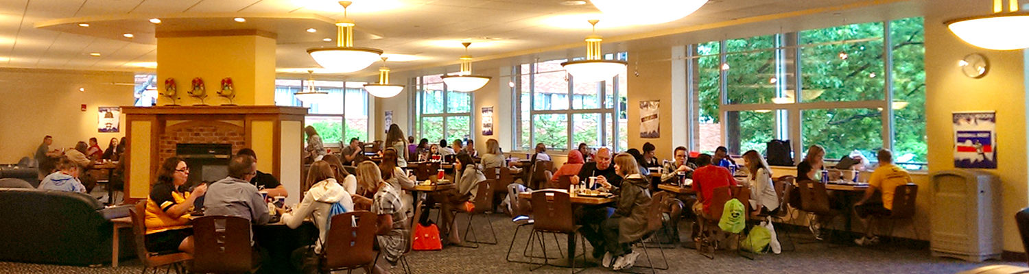 Students and families eat lunch in the Eastway Cafe