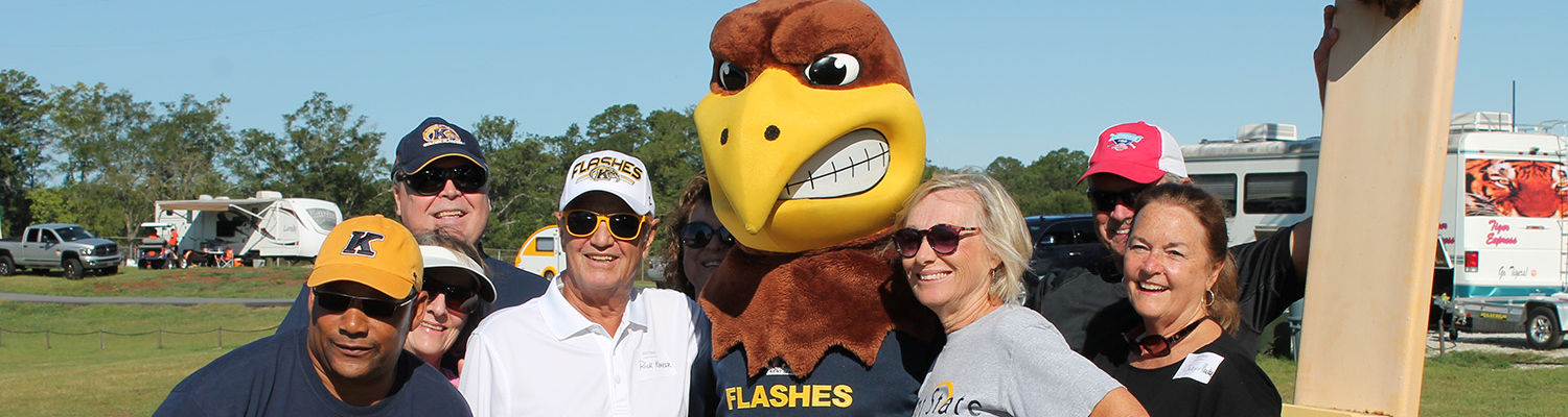 Alumni standing with Flash