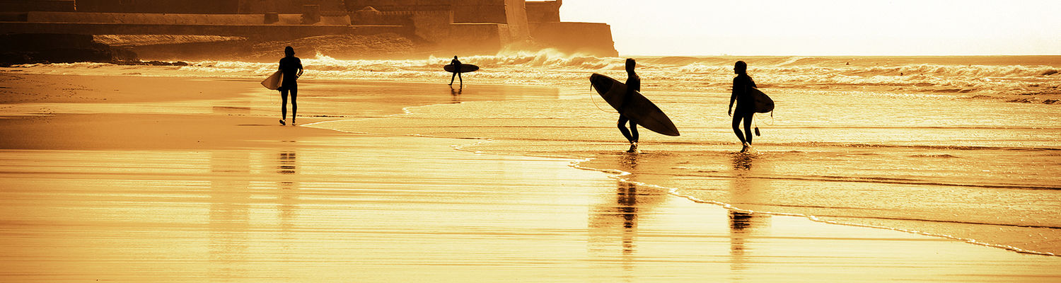 Surfers on a beach in Portugal.