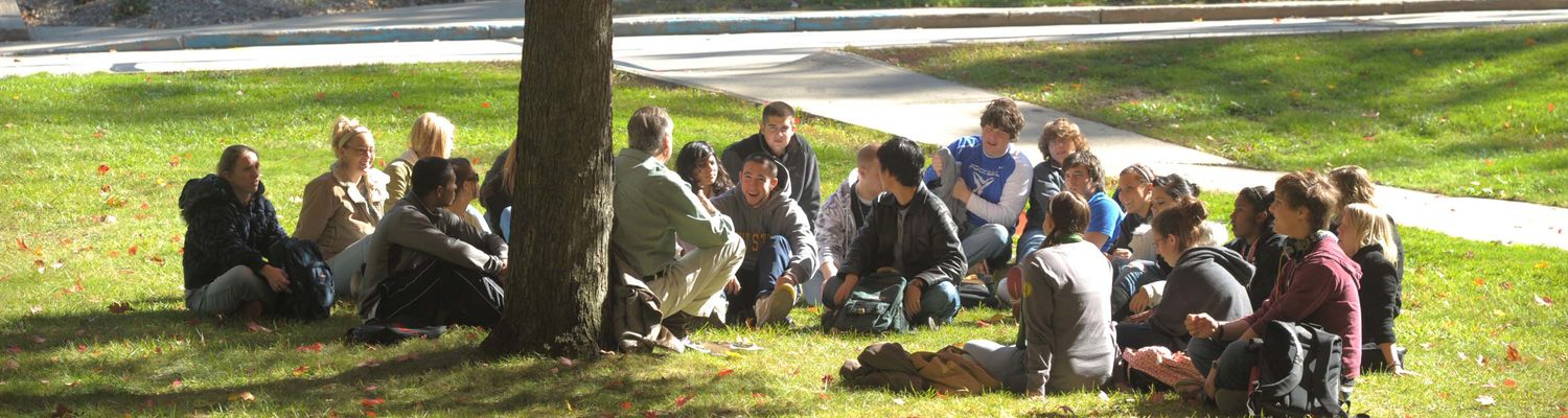 A faculty member holding a discussion with his class.