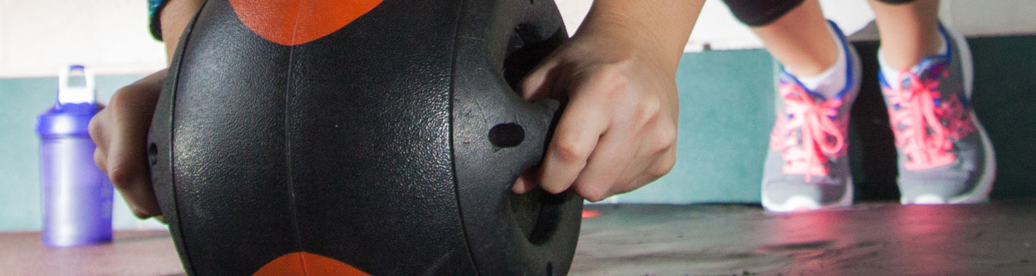 A student uses an ab roller
