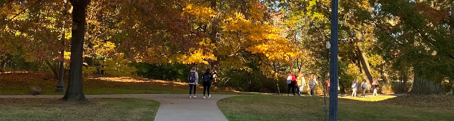 Students walking outside of Henderson Hall