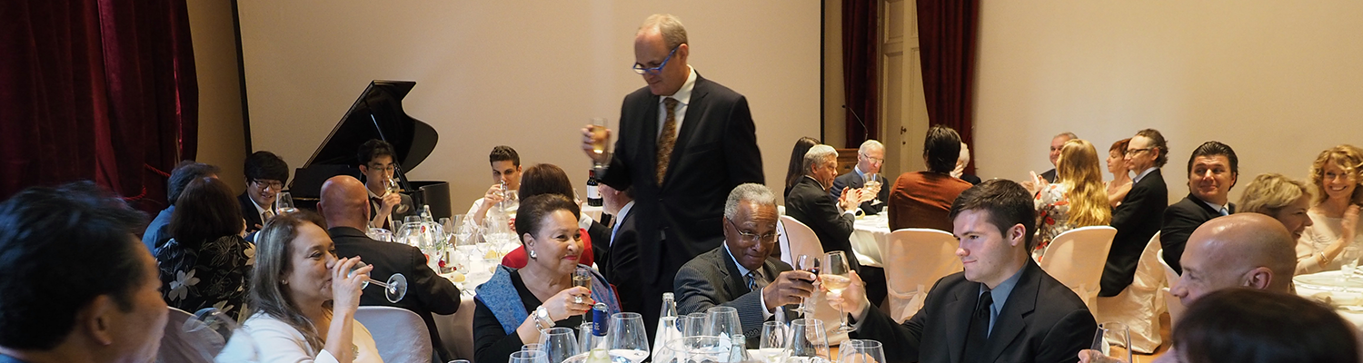 Dr. Diacon leads attendees in a toast at the reception dinner.