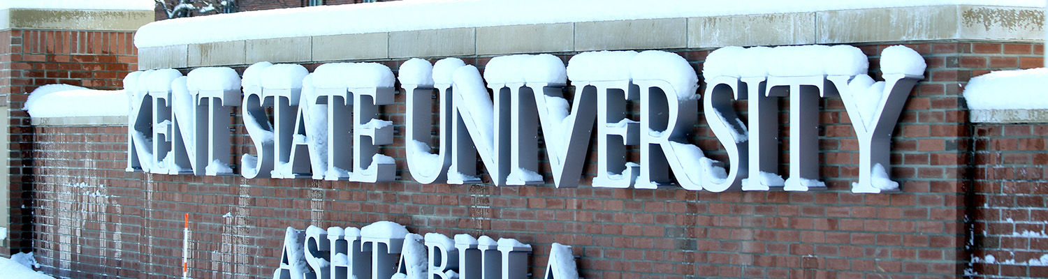 Ashtabula campus entry wall covered in snow