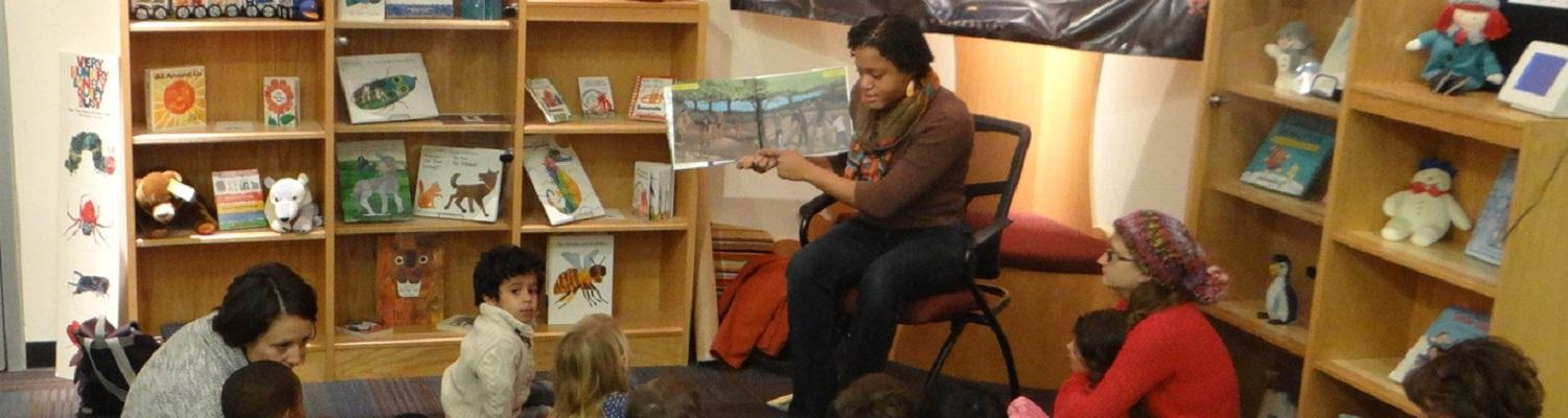MLIS student reading to children at the Reinberger Children's Library Center at Kent State University