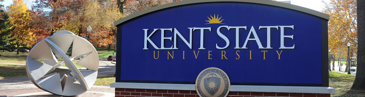 A sign near Franklin Hall and the Starsphere 2010 sculpture welcome visitors to the Kent State campus