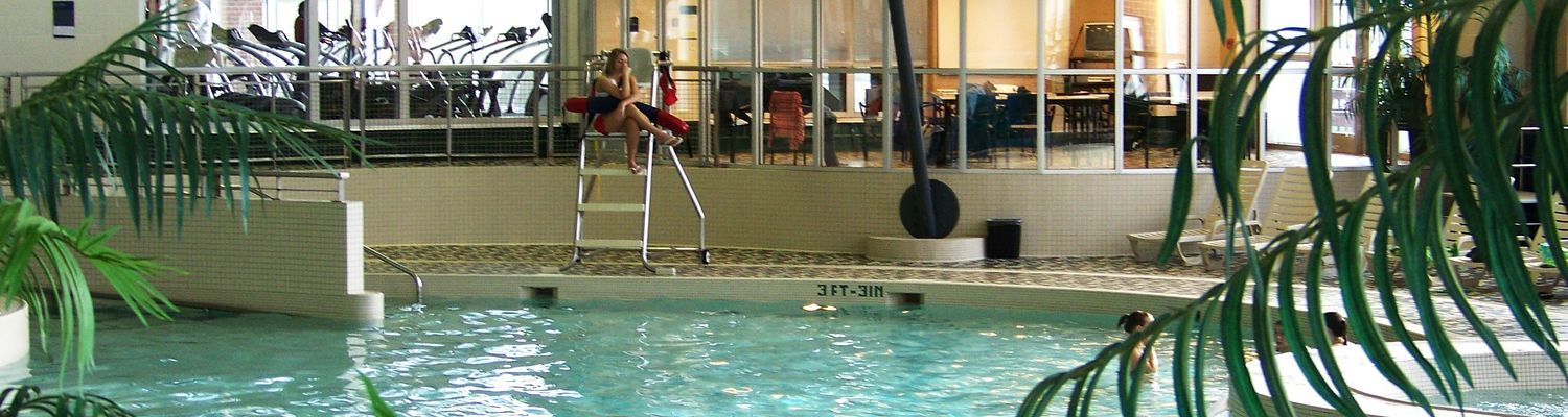 A lifeguard watches over the leisure pool in the Student Recreational and Wellness Center natatorium