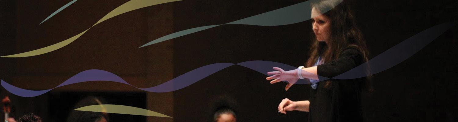 Kent State student leads high school orchestra rehearsal