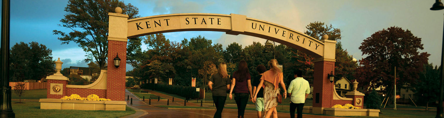 Students walk through the new arch on the esplanade extension that connects the Kent State campus with downtown Kent.