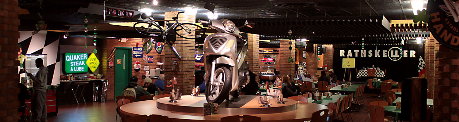 A moped sits on top of one of the lounge tables in Quaker Steak and Lube