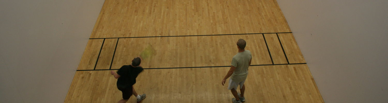 A couple students play a game of racquetball in the Student Recreation and Wellness Center