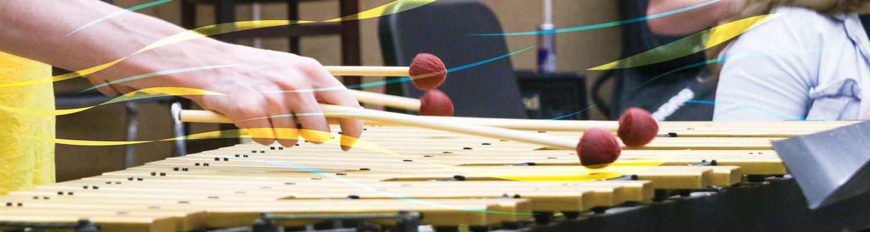 Student playing marimba