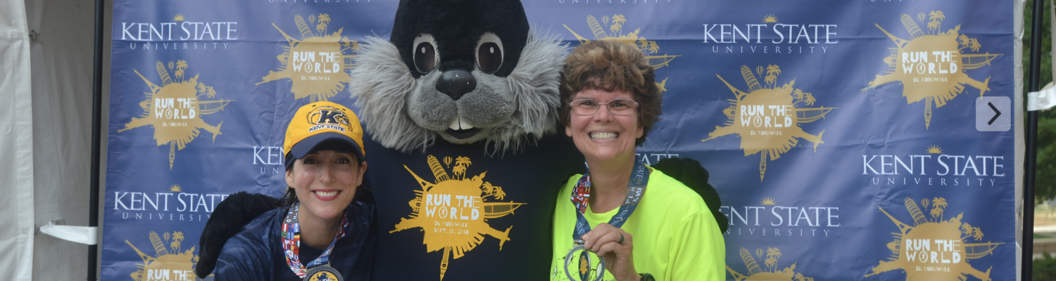 Dean Seachrist posing with Dr. Stasiowski and the black squirrel