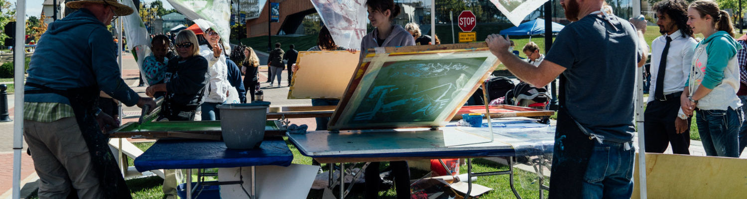 Participants try their hand at screenprinting