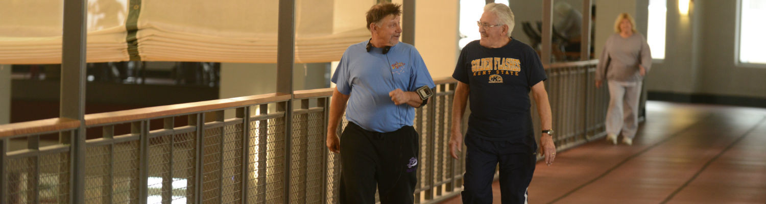 SilverSneakers members walk along the track on the top level of the Kent State Student Recreation and Wellness Center