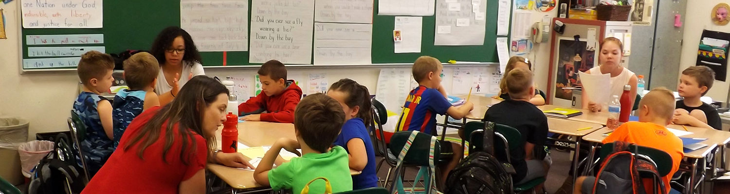 Children working in groups with mentors, Camp Read-A-Lot 2018