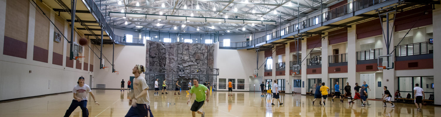 Games of basketball are being played on all four courts of the Sports Arena