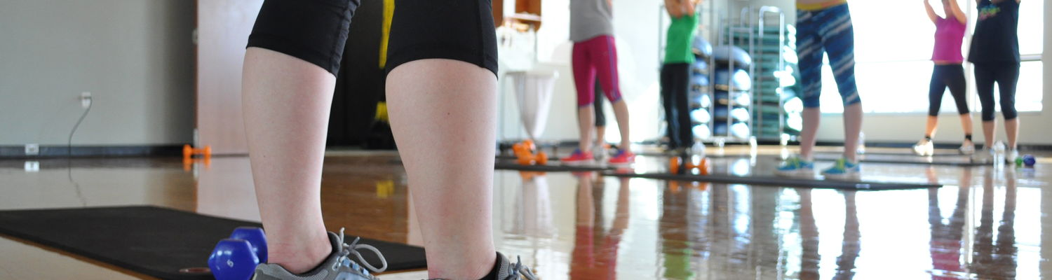A group of students work out in one of the studio rooms