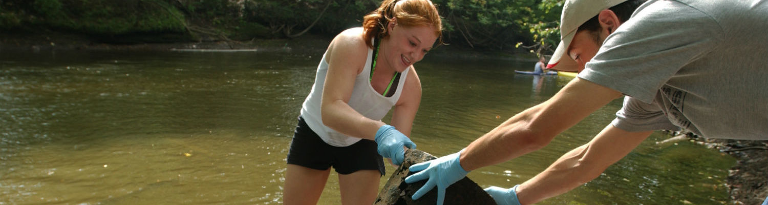 Students help clean a section of the Cuyahoga River near downtown Kent