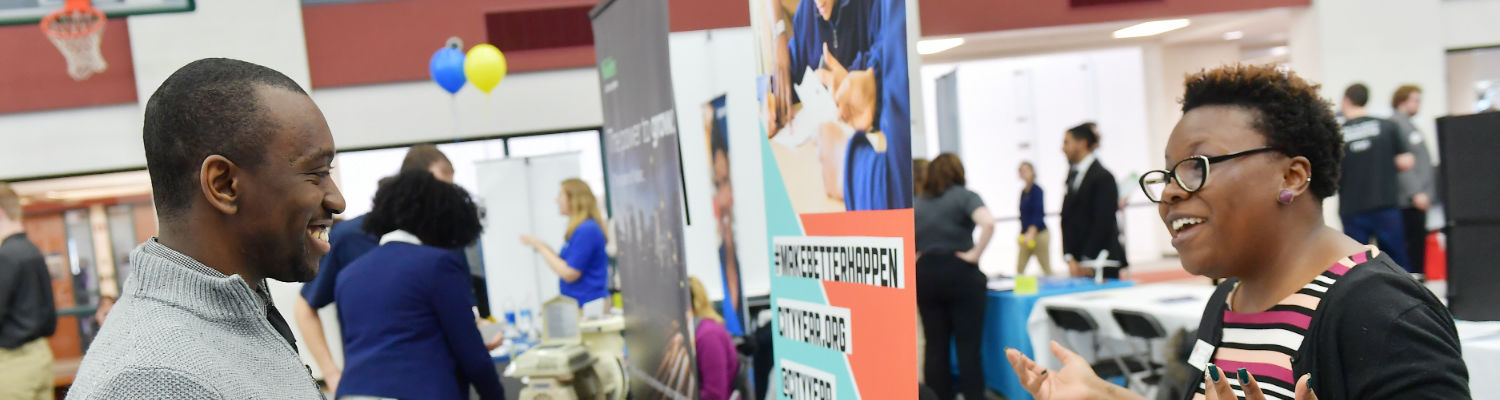 Student gets information at an information fair