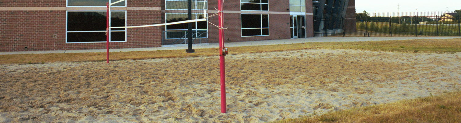 A sand volleyball court outside of the Kent State Student Recreation and Wellness Center