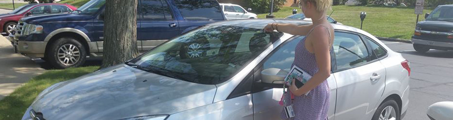 A student uses ZipCar on campus