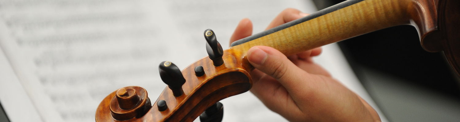 Violist with sheet music