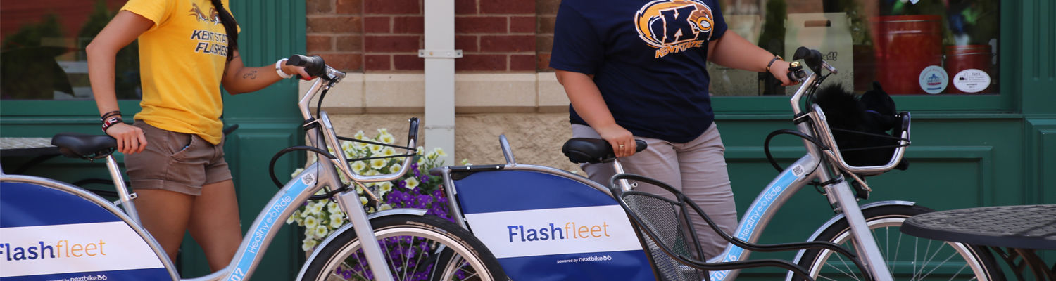 Two students with Flashfleet bikes in downtown Kent