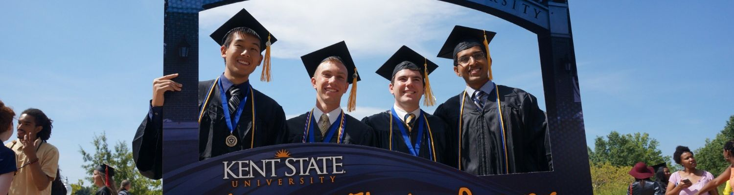 Graduates posing with a 'We Are #Flashesforever' sign