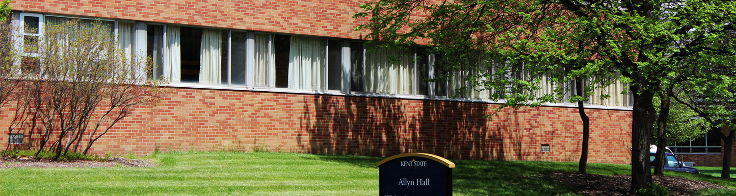 Outdoor shot of Allyn Hall with building sign on display