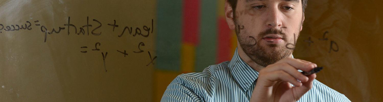 A student completes mathematics equations.